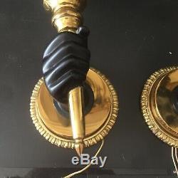 Belle paire d'appliques flambeaux main nubienne Art Deco en bronze