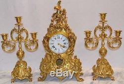 Garniture de cheminée style LOUIS XV en bronze / horloge + bougeoirs