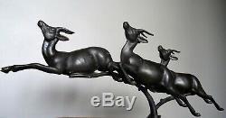 Groupe d' antilopes en course grand régule sur marbre vers 1930