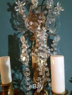 Importante paire d'appliques en bronze et cristal