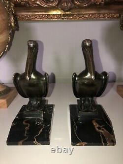 LAURENT GH & GUILLEMARD Fondeur. Serre livres Pelican en bronze ART DÉCO signés
