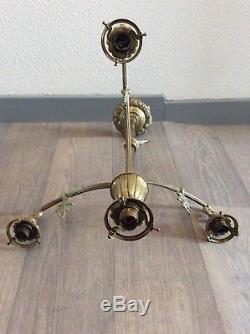 Monture de lustre quatre feux en bronze à décor floral géométrique Art Déco
