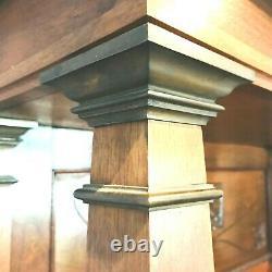 Paire de bibliothèques art déco acajou massif bague bronze au pieds. XX siècle