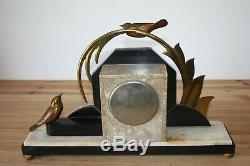Pendule Art Déco à décor d'oiseaux en bronze style E. Guy