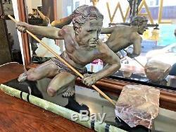 Sculpture ART DECO Homme à l'effort signée BUCHET, régule à patine bronze